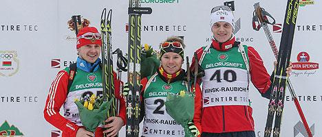 Winners of the 15km Individual Junior, Russia's Alexander Dedyukhiin, French Aristide Begue and Norway's Vemund Gurigard